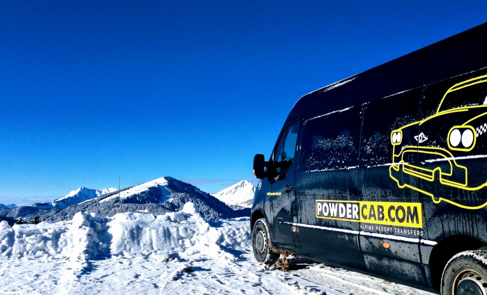 A minibus thats just driven to Avoriaz in snowy but sunny conditions